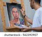 artist painting portrait of... | Shutterstock . vector #562392907