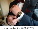 groom getting dressed and... | Shutterstock . vector #562397677