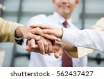 joy hand group teamwork join... | Shutterstock . vector #562437427