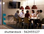 corporate team at table in a... | Shutterstock . vector #562455127