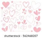 pink doodle heart designs on... | Shutterstock . vector #562468207