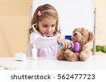 little girl treats a bear ...   Shutterstock . vector #562477723