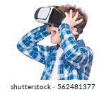 amazed teen boy wearing virtual ... | Shutterstock . vector #562481377