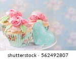 Pastel Colored Cupcakes With...