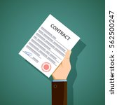 man holding in hand a document... | Shutterstock .eps vector #562500247