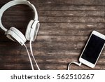 white headphones and smartphone ... | Shutterstock . vector #562510267