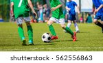 children soccer players running ... | Shutterstock . vector #562556863