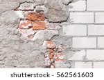 damaged grey plastered wall... | Shutterstock . vector #562561603