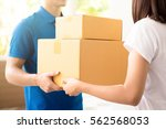 woman receiving packages from a ... | Shutterstock . vector #562568053