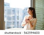 woman relaxing on balcony... | Shutterstock . vector #562594603
