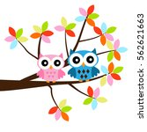 two owls sitting on the branch | Shutterstock .eps vector #562621663