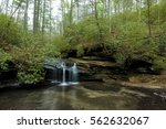 waterfall in the forest in... | Shutterstock . vector #562632067