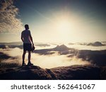 hiker silhouette standing on... | Shutterstock . vector #562641067