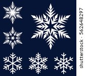 six white snowflakes set on a... | Shutterstock .eps vector #562648297