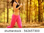 young woman running on the... | Shutterstock . vector #562657303
