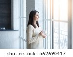 portrait of young woman near...   Shutterstock . vector #562690417
