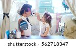 at home  in the bedroom  mother ...   Shutterstock . vector #562718347