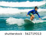 surfers waiting for a wave ... | Shutterstock . vector #562719313
