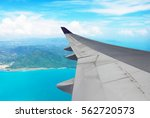 airplane flying over sea blue... | Shutterstock . vector #562720573