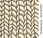 seamless pattern with knitted... | Shutterstock .eps vector #562724407