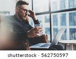 pensive bearded businessman... | Shutterstock . vector #562750597