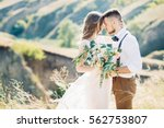 bride and groom hugging at the... | Shutterstock . vector #562753807
