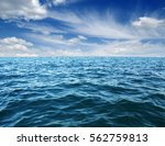 blue sea water surface on sky | Shutterstock . vector #562759813