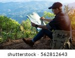 young man traveler with map... | Shutterstock . vector #562812643