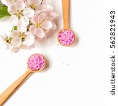 Small photo of Spa sea salt and flower branch for bath. Natural health care. Beauty, healthy therapy. Gray background. Fresh relax for body. Treatment for relaxation and wellness. Closeup aroma crystal.