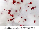 Stock photo red rose petals scattered on the white bath bubble on the jacuzzi tub top view 562852717