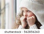 sad little girl sits alone.... | Shutterstock . vector #562856263
