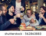 diverse people enjoy food... | Shutterstock . vector #562863883