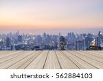 blurred dark night city... | Shutterstock . vector #562884103