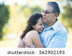 portrait proud hispanic father... | Shutterstock . vector #562902193