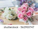 hands holding bouquet of flower ...   Shutterstock . vector #562903747