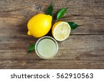 fresh lemon juice in small bowl ... | Shutterstock . vector #562910563
