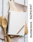 blank notebook with wooden... | Shutterstock . vector #562931947