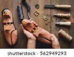cobbler tools in workshop dark... | Shutterstock . vector #562949293