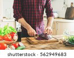 man cooking in kitchen at home...   Shutterstock . vector #562949683