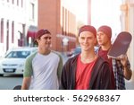 positive teenage friends with... | Shutterstock . vector #562968367