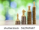 growing coins stacks with green ... | Shutterstock . vector #562969687