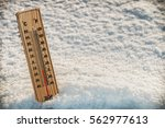 wooden thermometer in the snow... | Shutterstock . vector #562977613