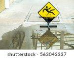 sign warning of caution wet...   Shutterstock . vector #563043337