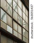 shipyard cranes   reflected in... | Shutterstock . vector #563051437