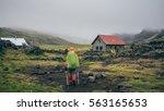 hiker. young woman hiking... | Shutterstock . vector #563165653