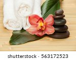 spa background. white towels on ... | Shutterstock . vector #563172523
