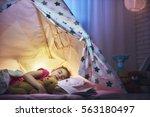 adorable little child girl is... | Shutterstock . vector #563180497
