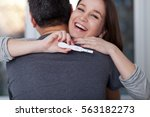 delighted young woman holding...   Shutterstock . vector #563182273