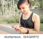 woman asian listening music in... | Shutterstock . vector #563184973