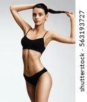 beautiful sporty woman in black ... | Shutterstock . vector #563193727